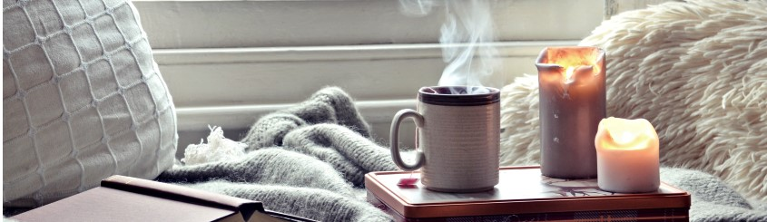 serene scene with candle, book, teacup