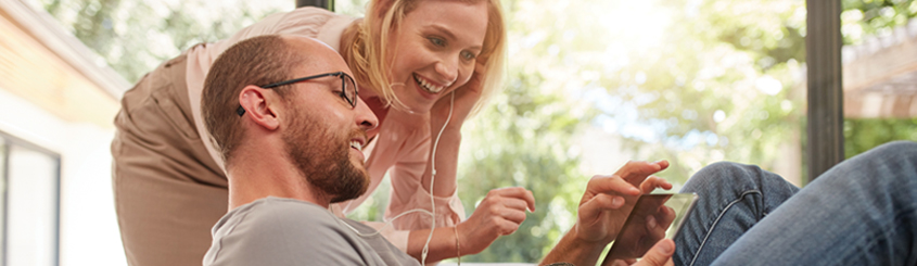 Couple selecting benefits on mobile device
