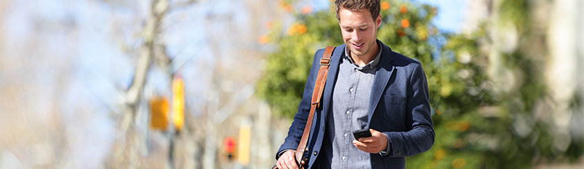 Man walking and looking at phone