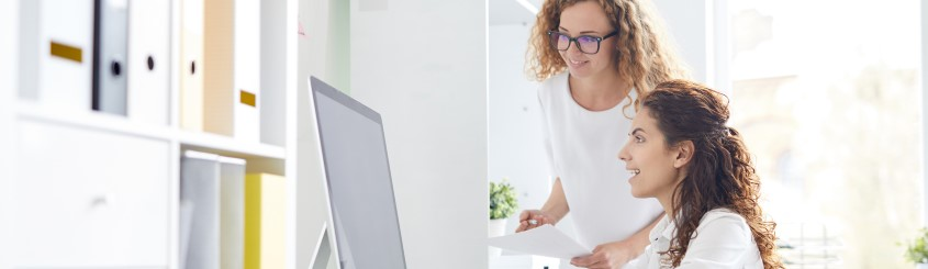 two women working near computer