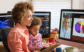 woman working from home with child on her lap